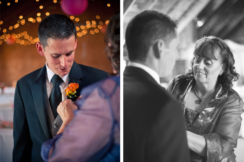 Mother of groom helping to apply boutonniere.