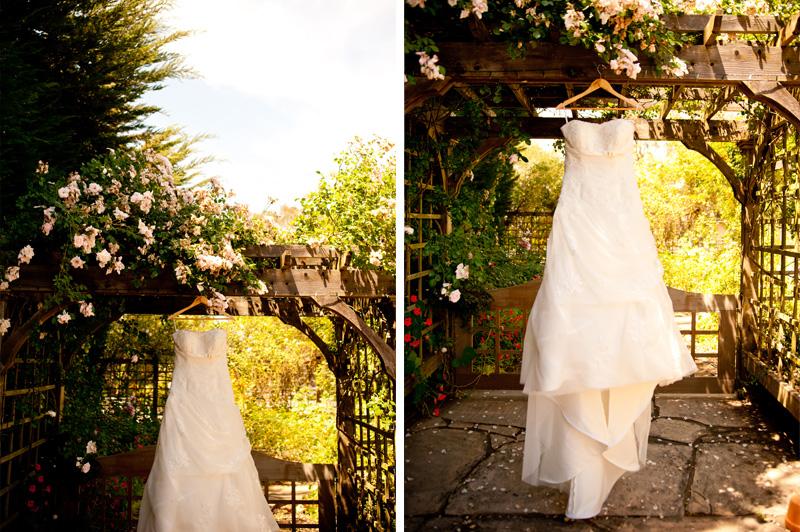 Wedding dress hanging in arbor
