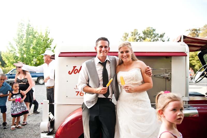Bride and groom at vintage ice cream truck