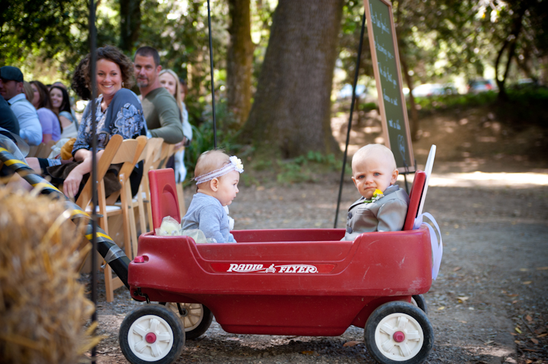 Baby flower girl and ringbearer being pulled in wagon