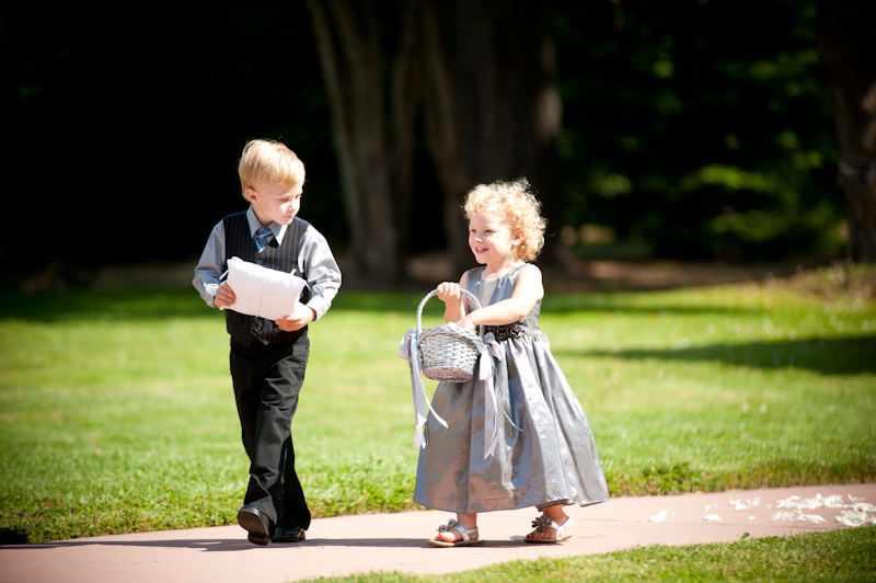Ringbearer and flower girl walking down the aisle