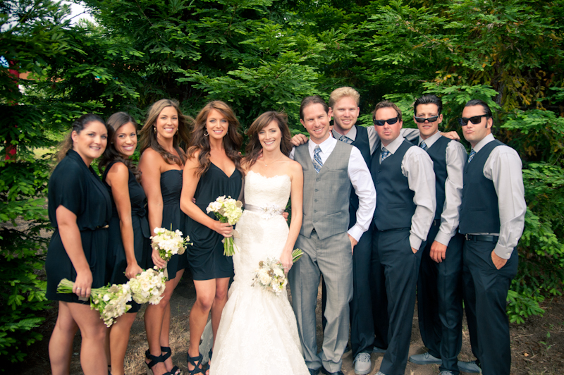 Casual portrait of wedding party in front of redwoods