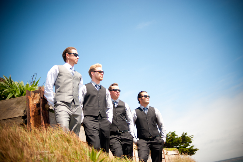 Portrait of groom and groomsmen on beach cliff