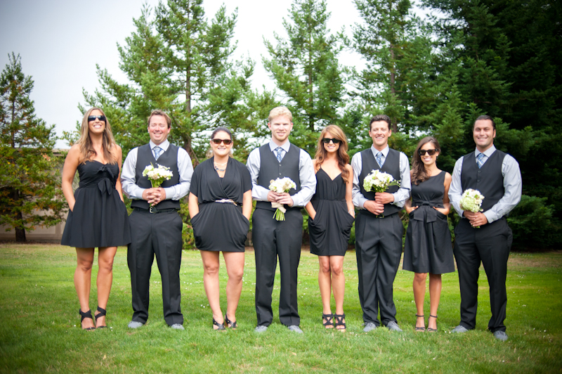 Groomsmen holding bouquets with bridesmaids wearing sunglasses