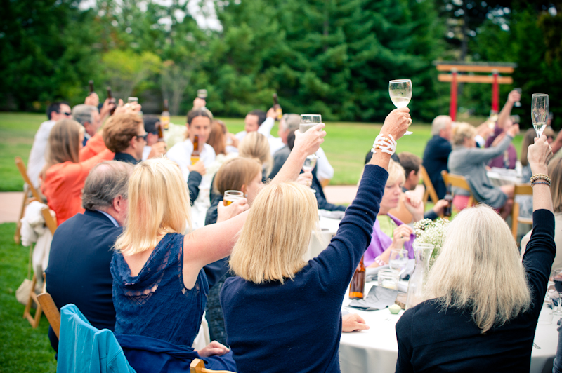 Guests raising glasses for toasts