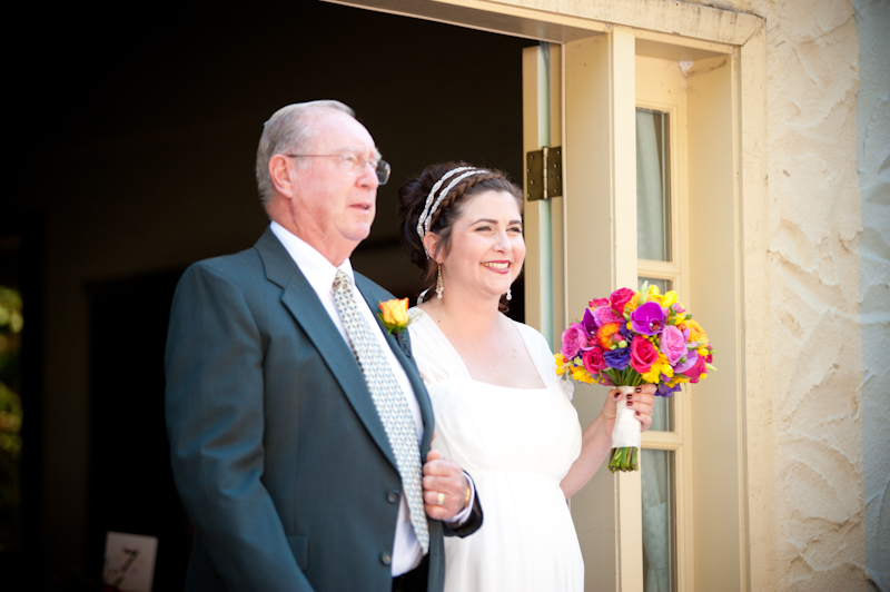 Bride walking down aisle with father at the Montclair Women's Club in Oakland, CA