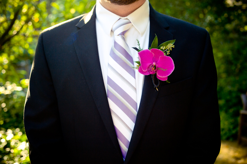 Detail of Groom with purple orchid boutonniere in Oakland, CA
