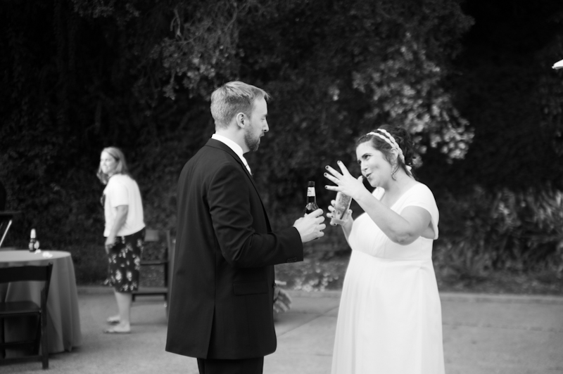 Bride and Groom exploding fist bump in Oakland, CA