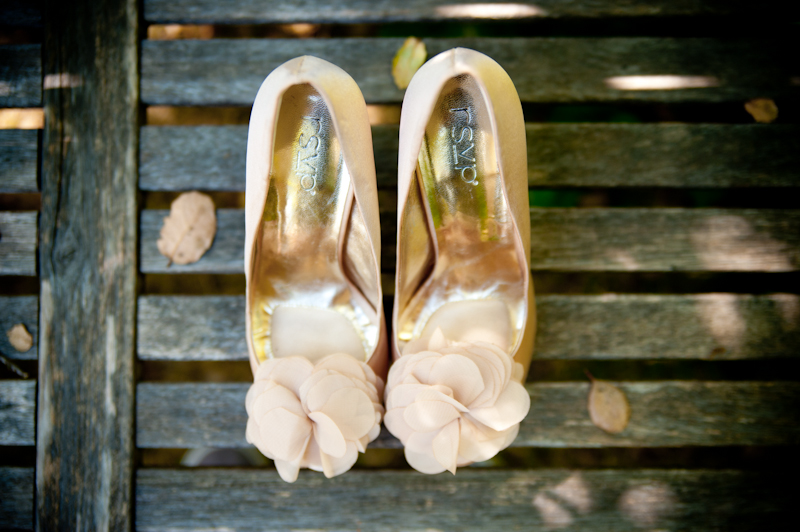 Bride's wedding shoes on wooden bench in Oakland, CA