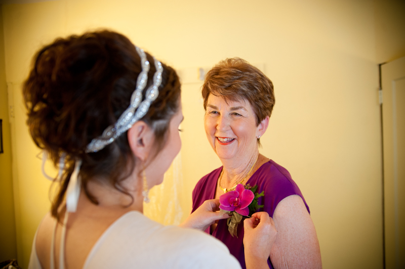 Bride helping mother with flower detail