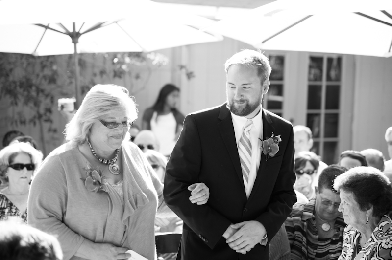 Groom and Mother of Groom walking down aisle in Oakland, CA