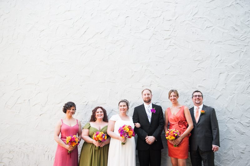 Colorful wedding party against grey wall at Montclair Women's Club