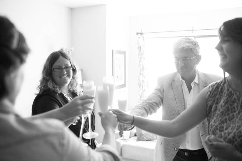 Family of bride toasting mimosas