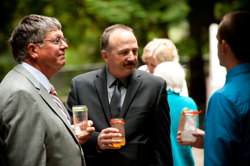 Candid photo of fathers of Bride during cocktail hour