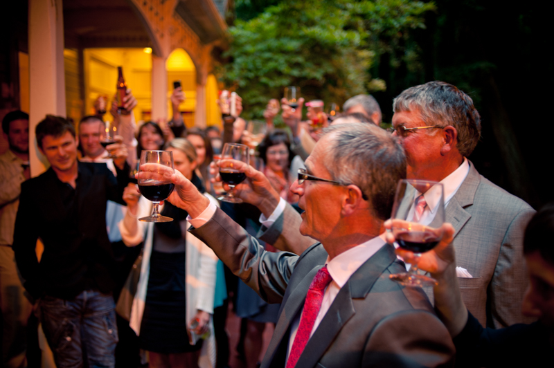 Wedding guests toasting couple on deck of Trocadero House at Stern Grove Wedding
