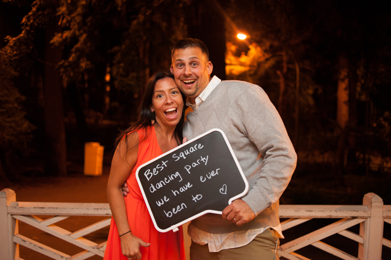 Wedding guests holding message to couple