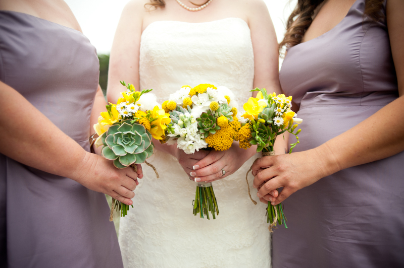 Close up of colorful wedding bouquets held by bride and bridesmaids