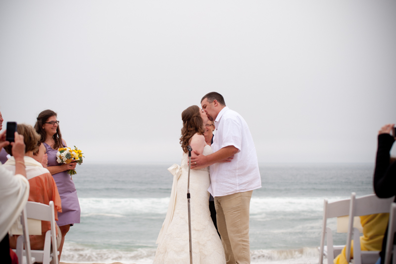 Bride and Groom first kiss after ceremony in Monterey Beach Wedding