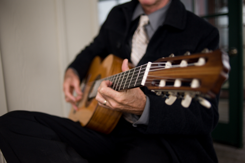 Detail of guitar player performing at wedding reception in Monterey, CA