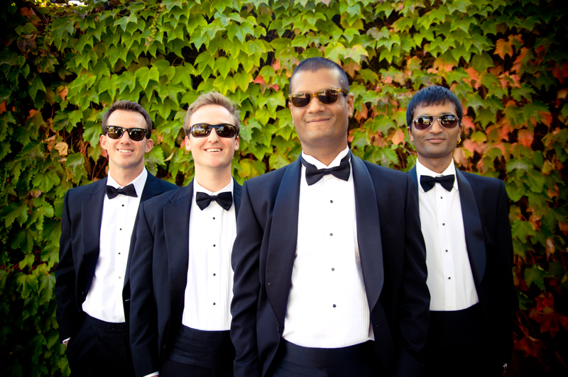 Groom and groomsmen wearing sunglasses and tuxedos