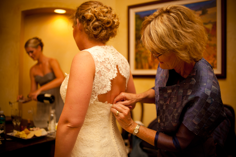 Mother helping Bride with wedding dress in Sonoma, CA