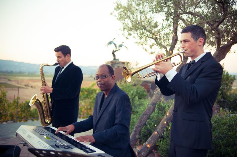 Portrait of live band playing wedding cocktail hour at Viansa Winery