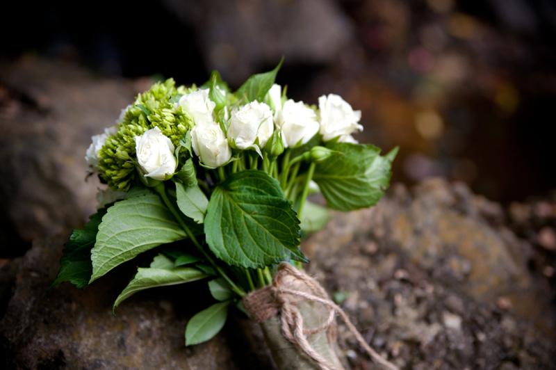 Wedding bouquet on stone in Oakland, CA