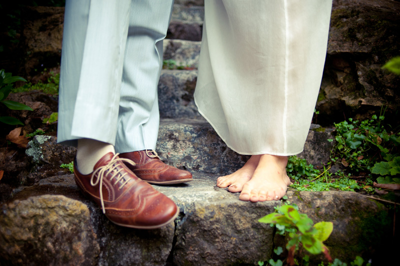 Detail of Bride's bare feet and Groom's shoes