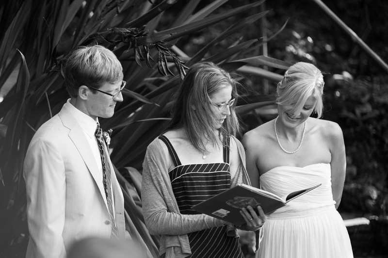 Wedding guest reading passage from book during ceremony