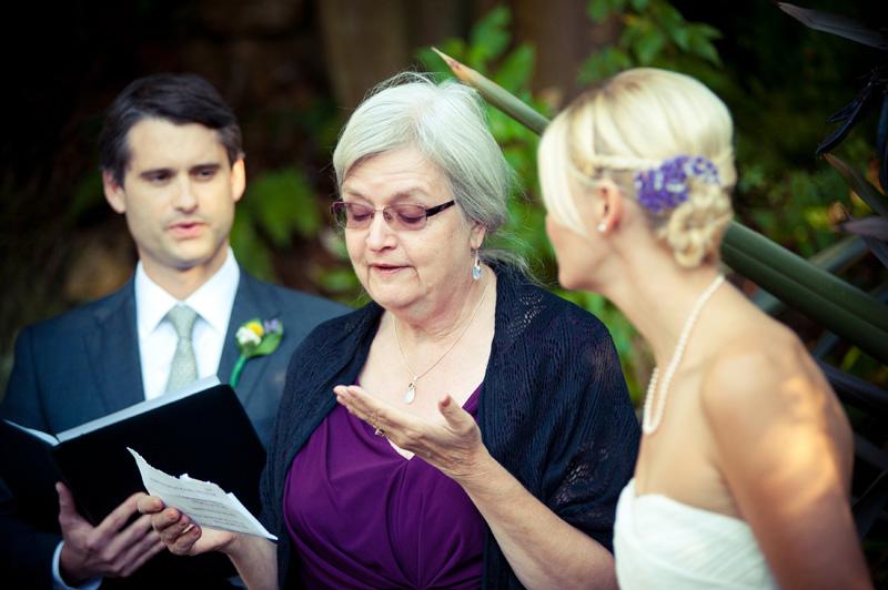Mother of bride speaking at wedding ceremony in Oakland