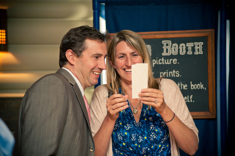 Guests using photo booth at Lake Temescal wedding