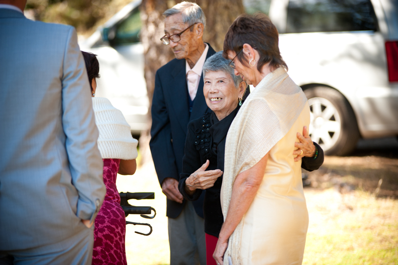Wedding guests greeting one another at Mar Vista Cottages