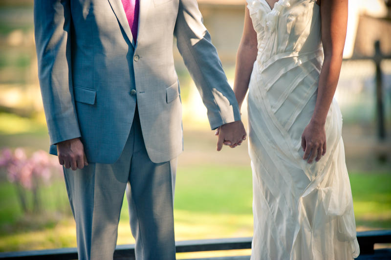 Detail of Bride and Groom holding hands during ceremony