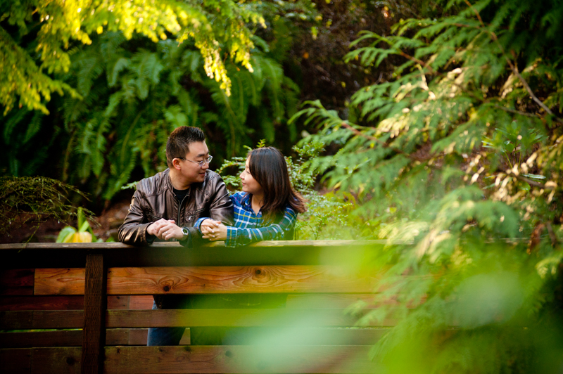 Candid moment of Husband and Wife on wooden bridge in Berkeley, CA
