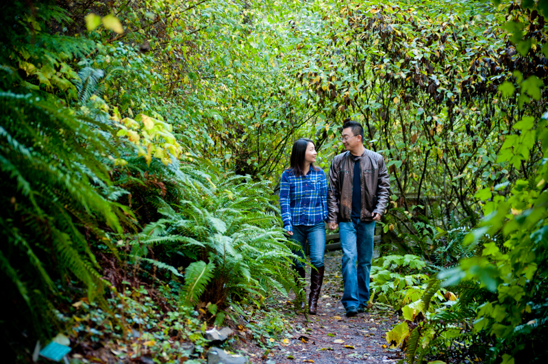 Husband and Wife walking on forest path during anniversary photo session
