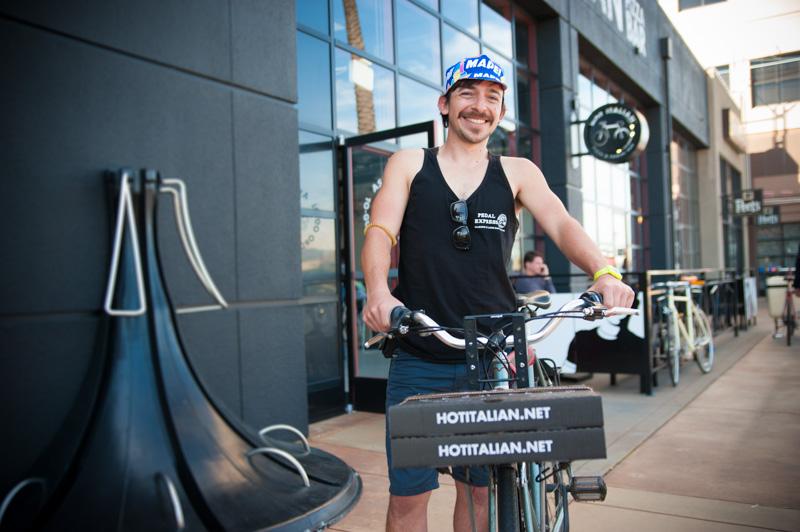 Portrait of bike messenger delivering pizza in Emeryville, CA