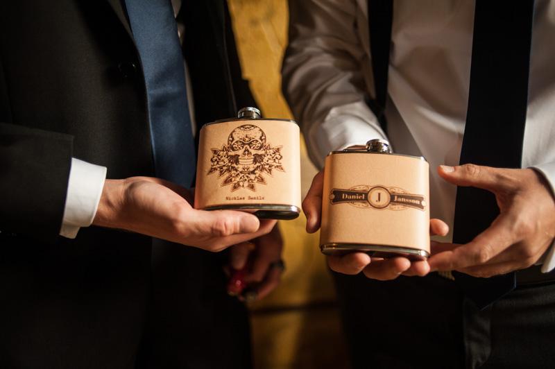 Groomsmen holding flasks