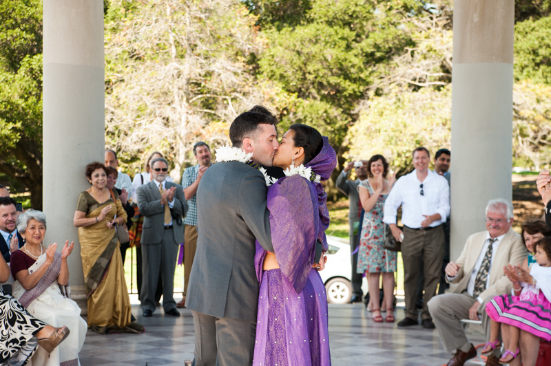 Bride and Groom kiss at Lake Meritt wedding