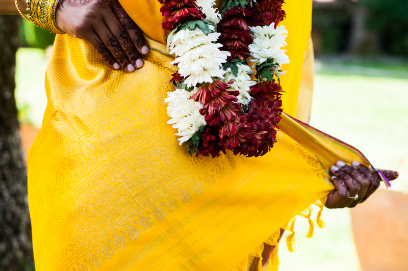 Detail of Indian wedding dress with flower garland