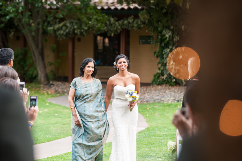 Bride walking down the aisle with mother