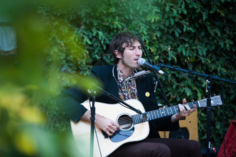 Matt Costa performing at house wedding