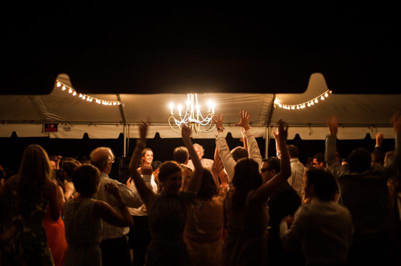 Guests dance under wedding tent