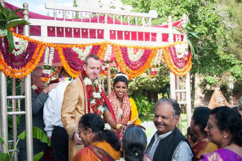 Couple greeting family after indian wedding ceremony