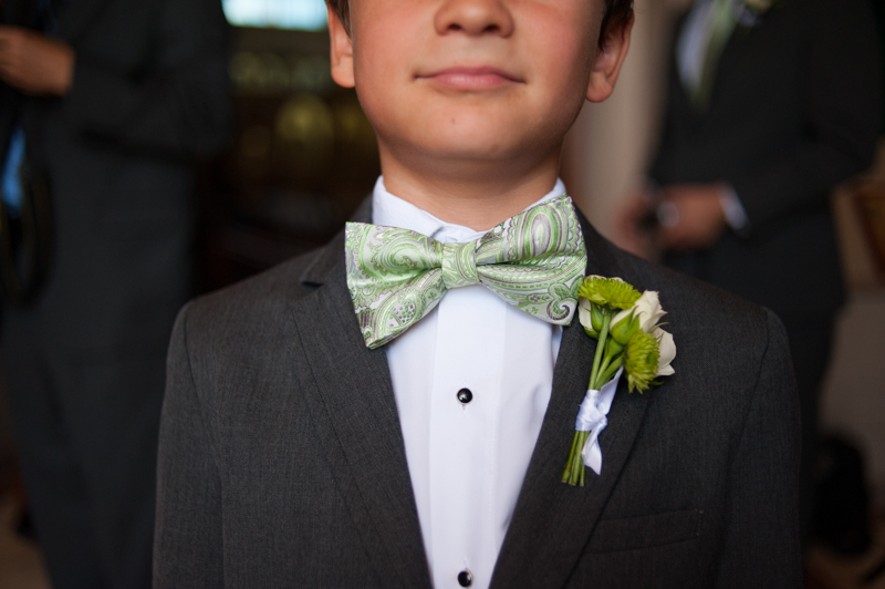 Detail of ring bearer wearing bowtie and boutonniere