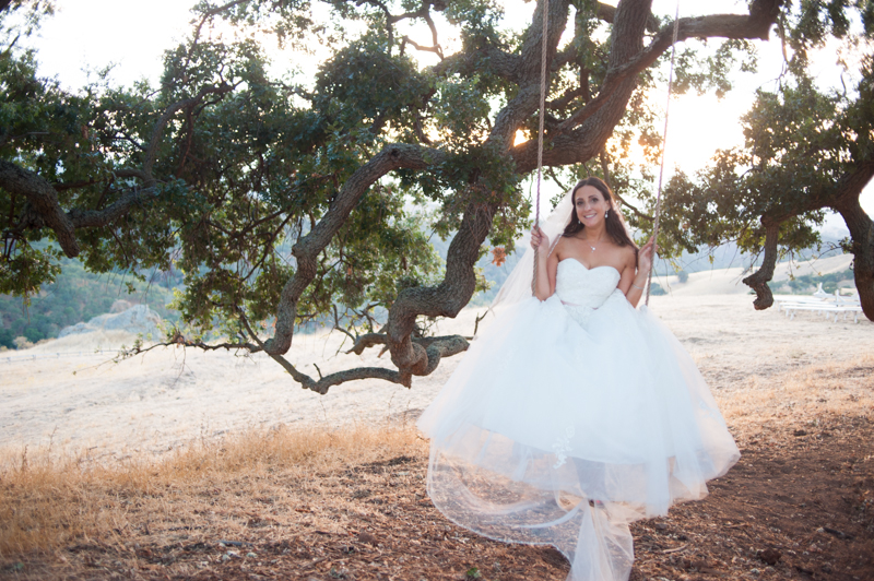 Bride sitting on swing at Diablo Ranch Events