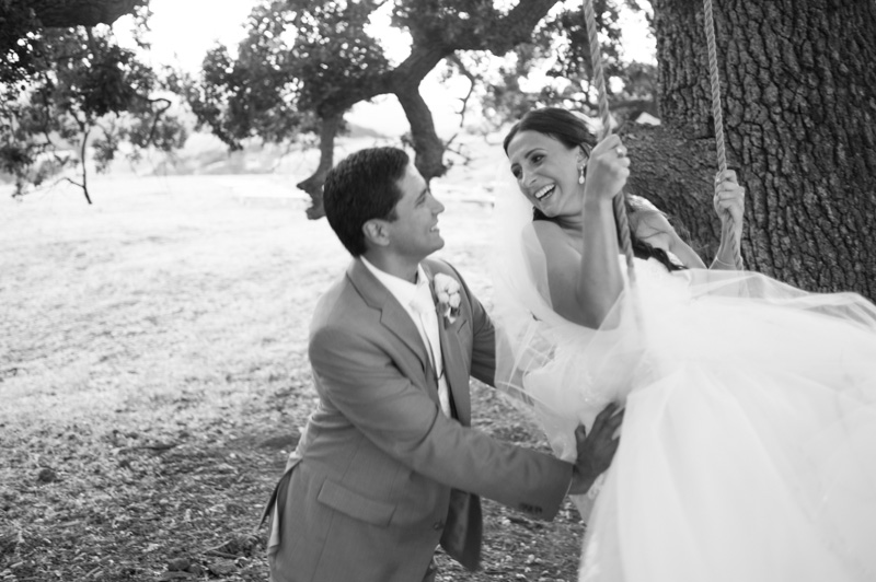Candid of Groom pushing Bride on swing at Diablo Ranch