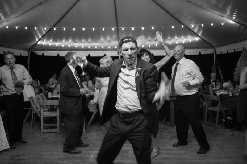 Father of bride dancing at wedding reception