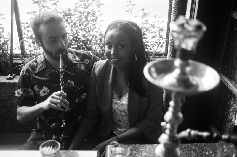 Engaged couple smoking at Hookah Bar