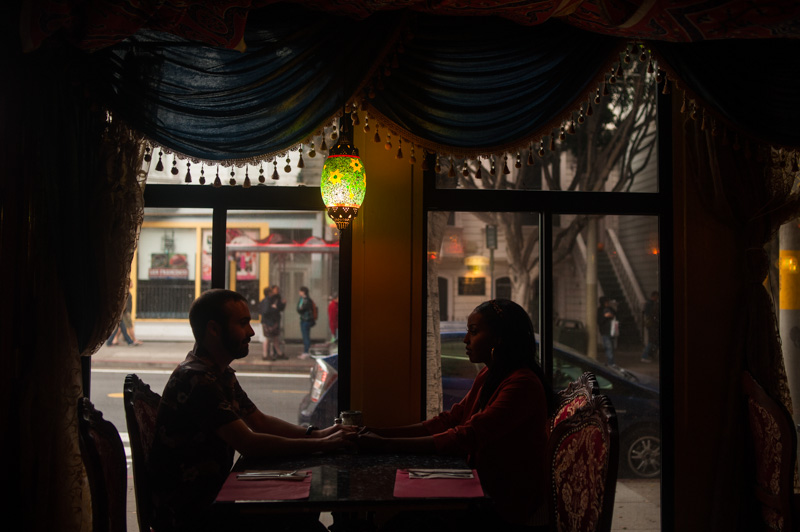 Silhouette of couple inside Hookah Bar in San Francisco