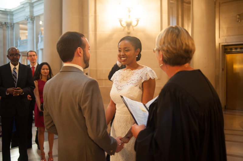 Bride smiling during wedding ceremony at San Francisco City Hall